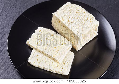Feta Cheese Cut In Slices On Plate