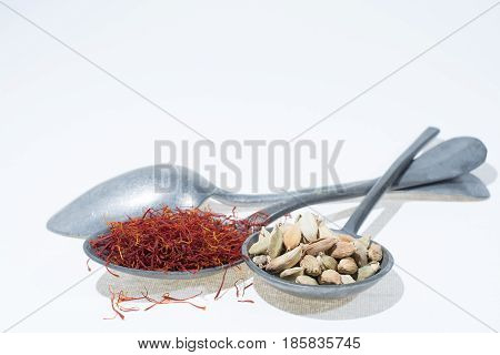 Raw Organic Red Saffron and Cardamom Spices copy space
