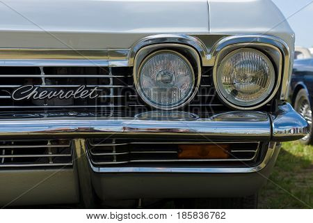 PAAREN IM GLIEN GERMANY - MAY 19: Headlamp Full-size automobile Chevrolet Impala Hardtop Coupe The oldtimer show in MAFZ May 19 2013 in Paaren im Glien Germany