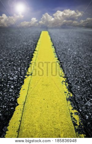 Close up asphalt road texture with yellow stripe