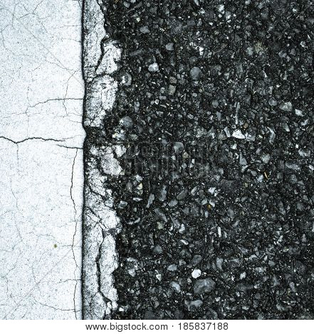 Close up asphalt road texture with white stripe