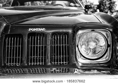 PAAREN IM GLIEN GERMANY - MAY 19: Headlamp Mid-size car Pontiac Grand Am (black and white) The oldtimer show in MAFZ May 19 2013 in Paaren im Glien Germany