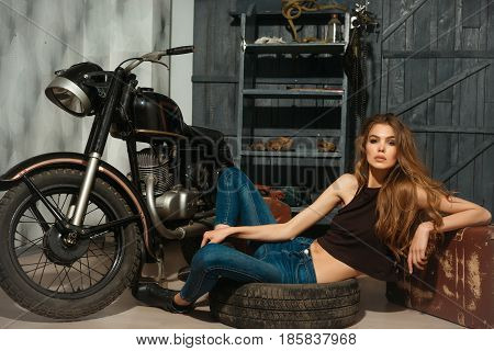 Sexy Girl Lying In Dirty Rubber Tire On Floor