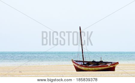 Fishing beat in Mozambique coast with low tide