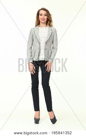 blond business woman in summer casual gray jacket back trousers high heeled shoes full body portrait isolated on white