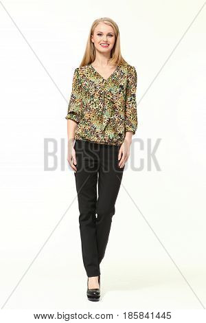 blond business woman in summer floral printed casual blouse black jeans trousers high heeled shoes full body portrait isolated on white