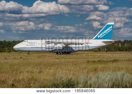 Kiev Region Ukraine - July 20 2012: Antonov An-124 Ruslan heavy cargo plane is taking off from the airport for another job - side view