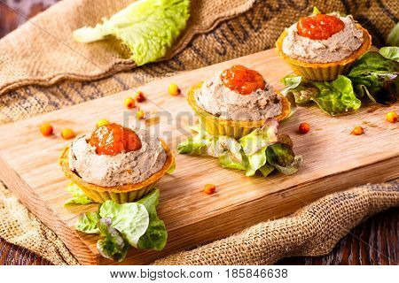 Tartlets With Liver Pate From Duck Or Chicken Livers And A Sauce Of Sea-buckthorn Are On The Board.