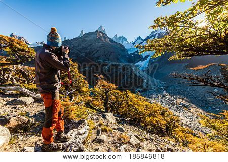 Bearded tourist man in the background of a mountain landscape.