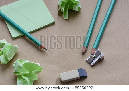 pencils sharpener eraser stickers brown paper with crumpled sticky notes creative crisis