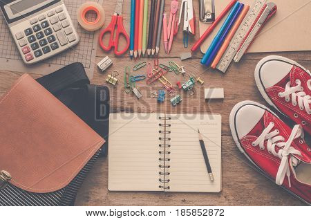 School supplies placed on a wood background concept ready for school.
