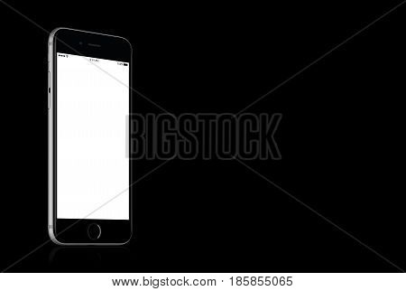 Varna, Bulgaria - March 10, 2016: Space Gray Apple iPhone 7 mockup with white blank screen on solid black background with copy space for your design. High quality studio shot.