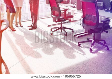 Low section of businesspeople standing in office