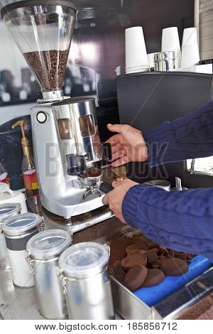 Cropped image of man preparing coffee at mobile coffee shop