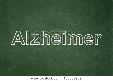 Healthcare concept: text Alzheimer on Green chalkboard background