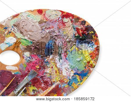 Artist's palette with colorful paint strokes and paintbrushes on white isolated background, top view, flat lay, object