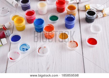 Artist workplace. Set of color gouache jars and acrylic paints