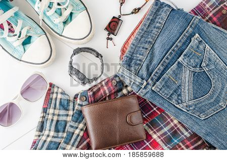Travel accessories costume Wallets watches shoes on a white background along for the trip.