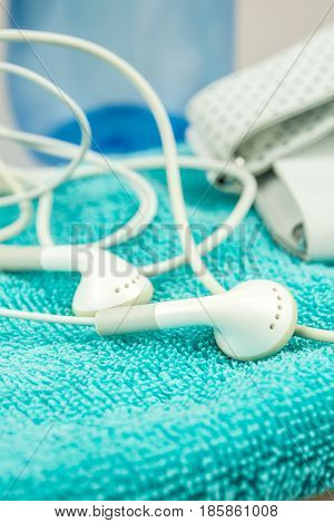 headphones mp3 player and turquise towel symbols of modern lifestyle sport fitness activities
