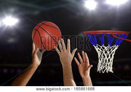 Basketball jump shot to the hoop with spotlight background