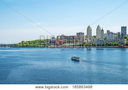 View from the bridge to Dnieper River and embankment of the city Dnipro