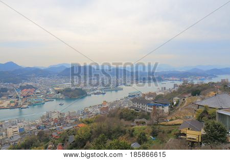 Onomichi city cityscape in Hiroshima Japan. Onomichi is a historical city with many temples and small alleys.