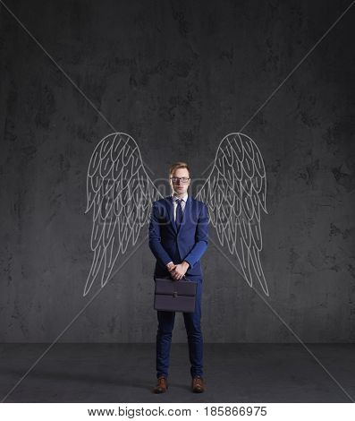 Business angel on a dark background. Investment, business, sponsor concept.