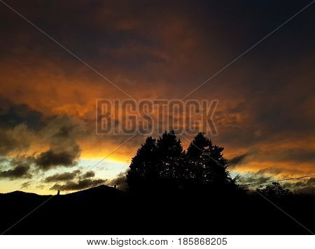 Italian sunset with vivid and ardent colors typical of a spring evening