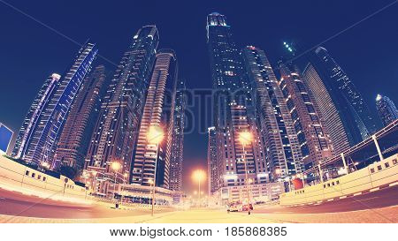 Fisheye Lens Picture Of Dubai Downtown At Night, Color Toning Applied, Uae.