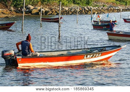 Labuan,Malaysia-May 10,2017:Traditional fisherman with fishing boat during morning in Tanjung Aru village,Labuan island,Malaysia.Aquaculture industry has growth,to contributes the economy of Labuan.