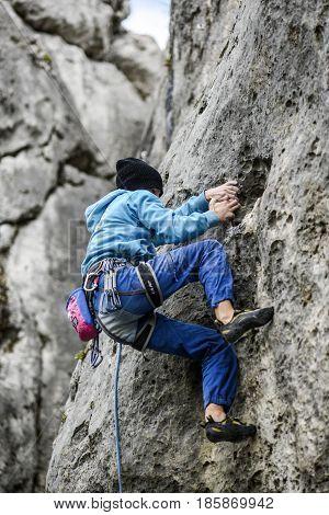 Podlesice Poland april 29 2017: Young male climber leading a route on a rock. Jura krakowska czestochowska. Poland