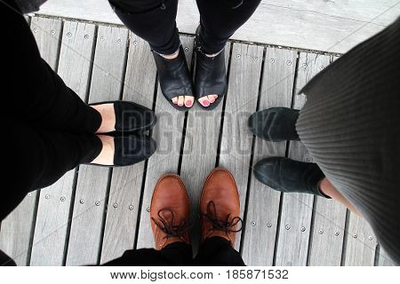 Looking down to the shoes on wooden background