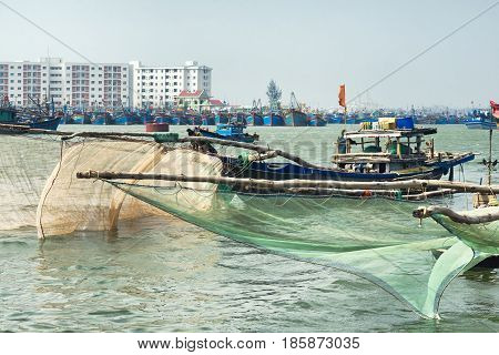 Wooden boats with large fishing nets in Da Nang, Vietnam