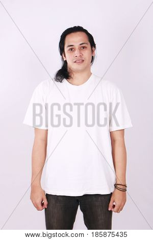Photo image of an Asian Model smiling and showing blank white T-Shirt front view shirt template