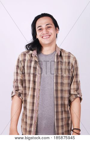 Photo image portrait of a cute young successful Asian male student with long hair in relaxed standing position half body portrait