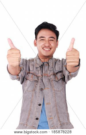 Photo image portrait of a cute young Asian man smiling and showing two thumbs up isolated on white