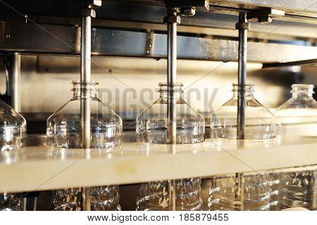 Sunflower oil production plant. Bottling line of vegetable oil in bottles