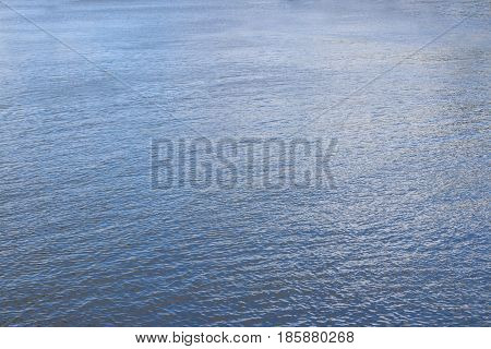 Surface of blue pure water of river at summer day background