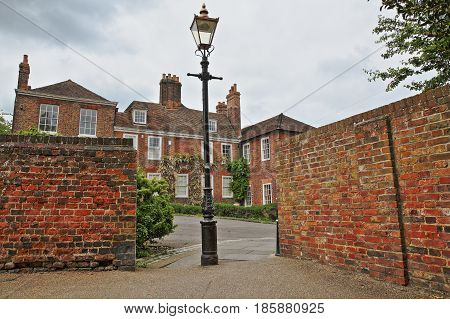 ROCHESTER, UK - MAY 9, 2017: Facades of houses  with a street lamp and colorful brick walls in the foreground