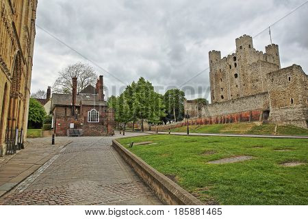 View of the Castle and the entrance of the Cathedral with Spring colors and cloudy sky in Rochester, UK