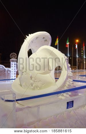PERM RUSSIA - FEB 1 2017: Sculpture Planet at evening Ice town of Perm in 2017 Ekosad - largest in Russia