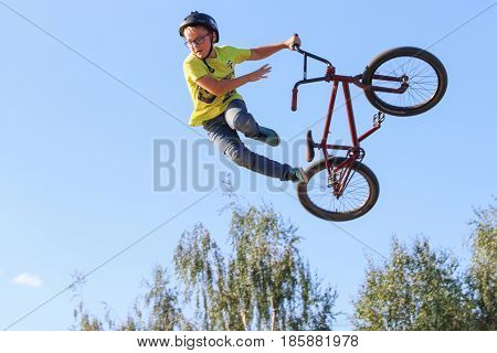 PERM RUSSIA - August 20 2016: the Kid in the yellow shirt and glasses is involved in the extreme event and jumps in aeromat in the Perm region