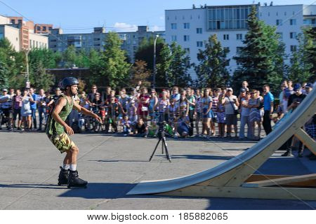 PERM RUSSIA - August 20 2016: Young man in helmet and green Jersey protective paint jumps during the event the Championship of Perm Krai jump aeromat
