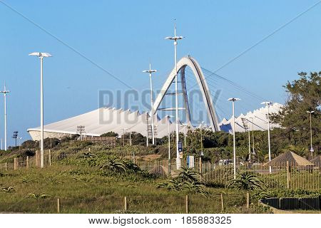 Dune Vegetation Against Moses Mabhida Stadium In Durban