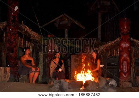 Maori People Women Sit Around Bonfire