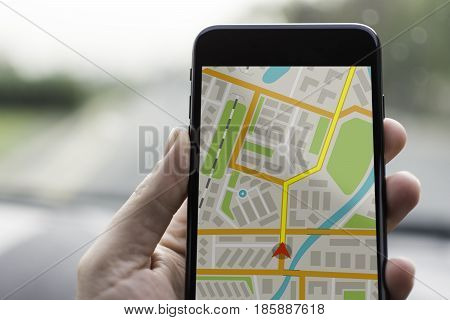 Gps Navigation On Mobile Phone Device And Transportation Concept. Male Hand Using Navigation System