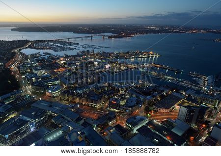 Aerial Landscape View Of Auckland City With Waitemata Harbour Bridge At Dusk