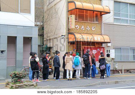 HIROSHIMA JAPAN - MARCH 18, 2017: Unidentified people queue at famous Tutafuji ramen noodle shop. Onomichi is famous for noodle calf Onomichi ramen.