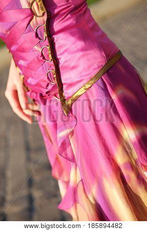 Flirty magenta and orange chiffon corset dress with lacing