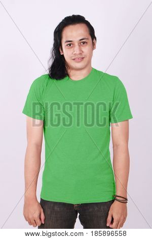 Photo image of an Asian Model smiling and showing blank green T-Shirt front view shirt template